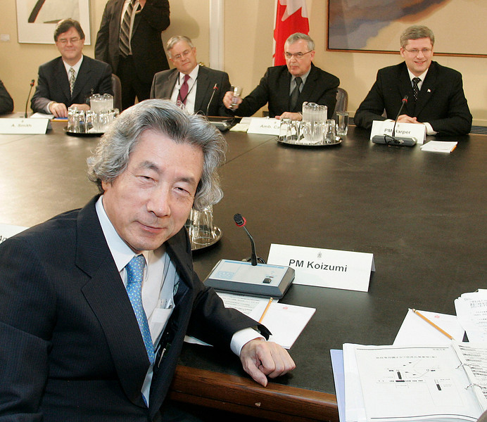 Japan's Prime Minister Junichiro Koizumi (L) meets with Canadian officials including Canadian Prime Minister Stephen Harper (R) on Parliament Hill in Ottawa, Wednesday, June 28, 2006. Photo by Patrick Doyle.