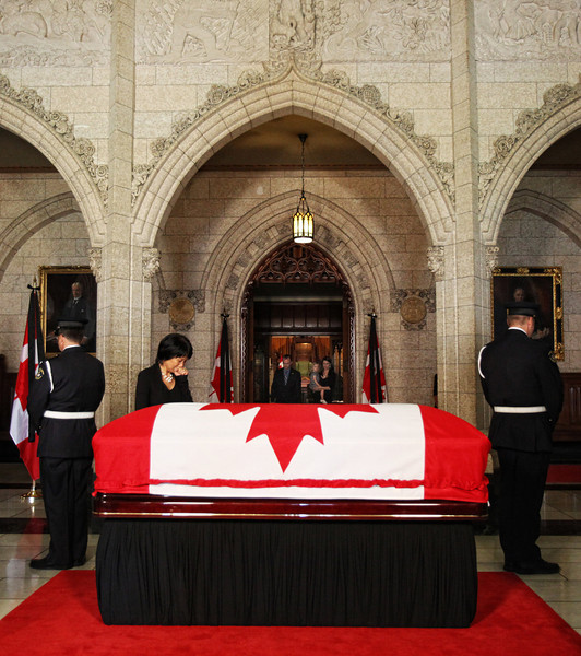 Olivia Chow stands before the coffin containing her husband and Canada's leader of the Opposition Jack Layton in the Center Block of Parliament Hill in Ottawa, August 24, 2011. Photo by Patrick Doyle.