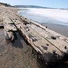 Record-Eagle/Nathan Payne<br /> The tip of a 40-foot-long section of a shipwreck juts out into the icy water of Lake Michigan near the Crystal River. Violent winter storms unearthed a large piece of what one archaeologist believes may be a 200-year-old sailing vessel.