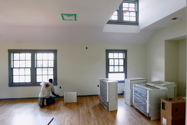 Record-Eagle/Jan-Michael Stump<br /> Rob Dezelski (cq) of Novak Painting and Wall Covering preps trim for painting in a future classroom at The Frankfort Art Center's new Elizabeth Lane Oliver Center for the Arts.