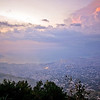 Photo courtesy of Jared Kohler<br /> Fast moving clouds open up to reveal the sunset panorama of Port Au Prince and Carrefour Haiti.