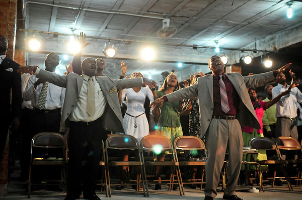 Photo courtesy of Jared Kohler<br /> Churchgoers sing at the Family Tabernacle of Praise in Carrefour, Haiti.