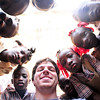 Photo courtesy of Jared Kohler<br /> Jared Kohler is surrounded by new friends at the Taifer school.