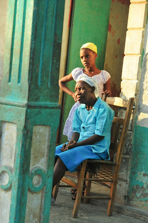 Photo courtesy of Jared Kohler<br /> Two generations of Haiti look out from the front door near Jacmel in southern Haiti.