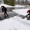 Record-Eagle/Keith King<br /> Dylan Waskiewicz, 16, and his sister Riley Waskiewicz, right, 13, shovel the driveway at their home Wednesday, April 20, 2011 during their snow day.