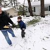 Record-Eagle/Keith King<br /> Alan Martin, of Ohio, removes fallen tree limbs Wednesday, April 20, 2011 with the help of his grandson, Isaiah Stottmann, 8, of Traverse City.