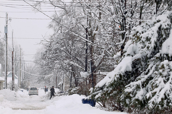 Record-Eagle/Keith King<br /> Heavy snow blankets a neighborhood Saturday, March 3, 2012 in Traverse City.