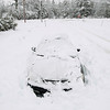 Record-Eagle/Keith King<br /> Snow surrounds a vehicle parked Saturday, March 3, 2012 on South Timberlee Drive near East Fouch Road in Elmwood Township.