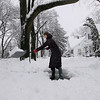 "Record-Eagle/Keith King<br /> Courtney Hanley, of Traverse City, shovels snow Saturday, March 3, 2012 from the sidewalk in front of a house she's watching for a friend. ""It's pretty crazy,"" Hanley said of the heavy snowfall."