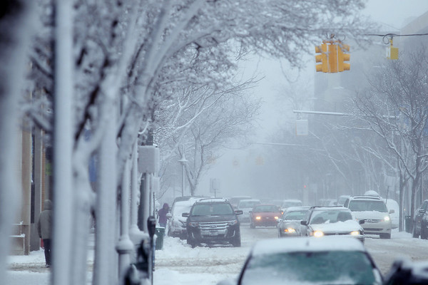 Record-Eagle/Keith King<br /> Traffic travels as snow accumulates along East Front Street Tuesday, January 17, 2012 in downtown Traverse City.
