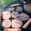 Record-Eagle/Douglas Tesner<br /> Hamburgers, hot dogs and beans wait on the grill.