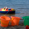 Record-Eagle photo/Jan-Michael Stump<br /> Connor Whyte, 7, of Rockford, floats on a tube at the Traverse City State Park beach on Grand Traverse Bay's east arm. Whyte, who was visiting his grandmother Nancy Whyte, of Traverse City, was not able to swim on two visits last summer because of the advisories.