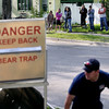 Record-Eagle/Keith King<br /> Onlookers stand along Second Street as a bear trap is moved into place Sunday, May 29, 2011 in Traverse City.