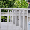 Record-Eagle/Keith King<br /> A black bear looks toward Michigan Conservation Officer Sean Kehoe Sunday, May 29, 2011 between two buildings located near Second Street and Division Street.