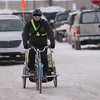 Record-Eagle/Keith King<br /> Ross Hammersley, of Traverse City, pedals his bike as his son, Emerson Hammersley, 6, rides in a bike trailer Wednesday, February 6, 2013, as Ross takes his son to school. Afterward, Hammersley continued riding his bike to work.