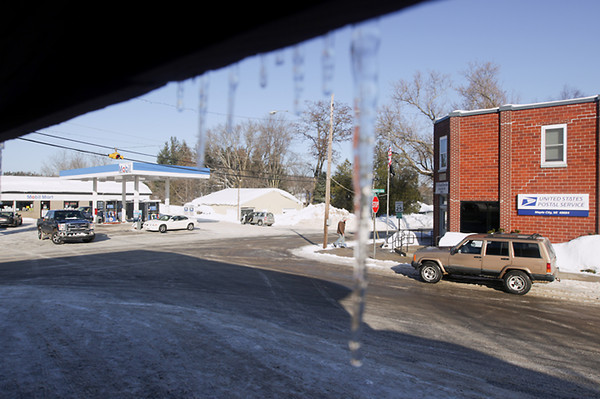 Record-Eagle/Keith King<br /> Sun shines near icicles in Maple City.