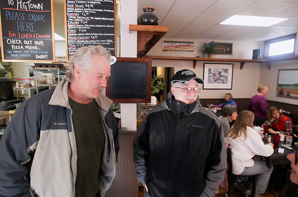 Record-Eagle/Keith King<br /> Paul Kint, left, and Mike Leith, talk in Pegtown Station, in Maple City, about this winter's snowfall.