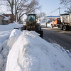 Record-Eagle/Keith King<br /> A Leelanau County Road Commission front-end loader picks up snow to put in a trailer as snow is removed in Maple City.