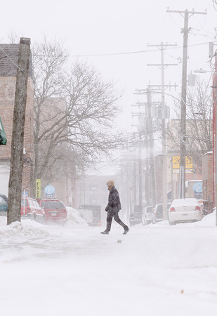 Record-Eagle/Keith King<br /> A pedestrian walks along Union Street through blowing snow in downtown Traverse City.
