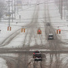 Record-Eagle/Douglas Tesner<br /> The intersection of South Airport and La Frainer Roads is snow covered after a late March snow storm moved through the area Sunday.