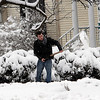 "Record-Eagle/Douglas Tesner<br /> St. Francis Catholic High School sophomore Spencer Nootke, clears snow from his mother's driveway on Cass Street. "" I just wish it happened on Monday,"" Nootke said.  ""It would have been nice to have a snow day."""