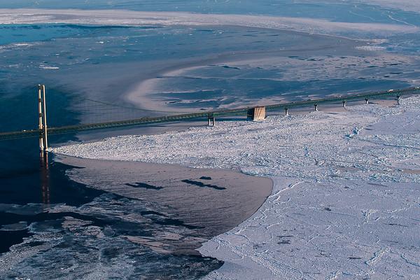 Record-Eagle/Pete Rodman<br /> Sun reflects of off ice near the Mackinac Bridge on Friday.