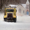 Record-Eagle/Jan-Michael Stump<br /> A plow clears Pine Street on Thursday morning.