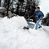 """Record-Eagle/Jan-Michael Stump<br /> """"This stuff is nothing but heavy,"""" said Bob Miller of the wet snow he shovels from the driveway of his neighbor's home on Chippewa Street on Wednesday afternoon."""