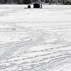 Record-Eagle/Douglas Tesner<br /> Tracks in the snow and ice lead the way to ice fisherman taking advantage of the warming weather to fish on Arbutus Lake #5 in East Bay Township.