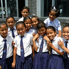 Special to the Record-Eagle/Karen Nelson<br /> Some of Nelson's students, in this case all girls, sport National Cherry Festival pins on their ties, a representative gift she brought to Nepal.