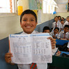 Special to the Record-Eagle/Karen Nelson<br /> A student shows a workbook in a private school in Nepal.
