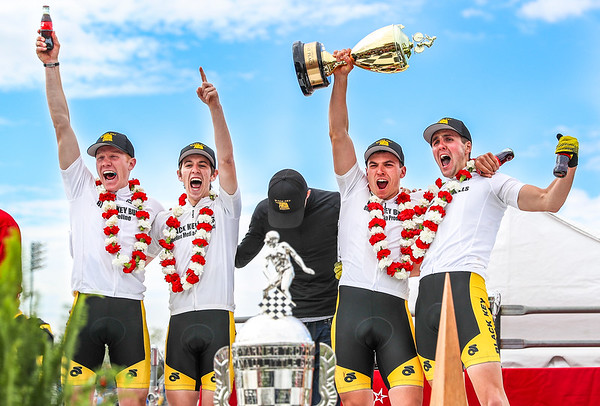 Riders for the Black Key Bulls celebrate with Coke after winning the Indiana University Little 500 at Bill Armstrong Stadium in Bloomington, IN. The race is the largest event of the year for the school and has been a tradition for decades.
