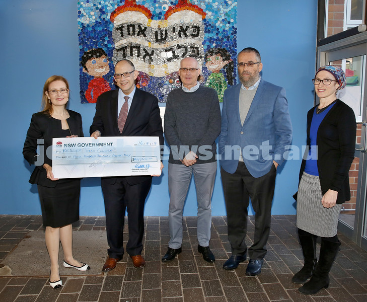 Local State MP Gabrielle Upton presents Kesser Torah College principal Roy Steinman with a cheque for $400000. Together with School CEO Saville Abramowitz, School president Meir Moss and  School Vice president Ilana Kaplan. Pic Noel Kessel