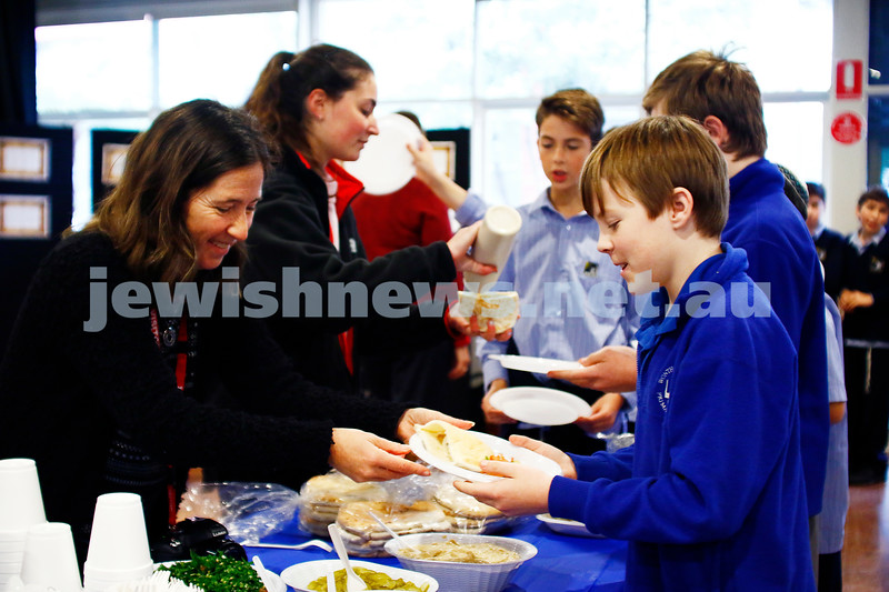 22-6-17. Students from Wonthaggi High School visit Leibler Yavneh College and share some falafel for lunch. Daniella Gozlan serving a Wonthaggi student. Photo: Peter Haskin
