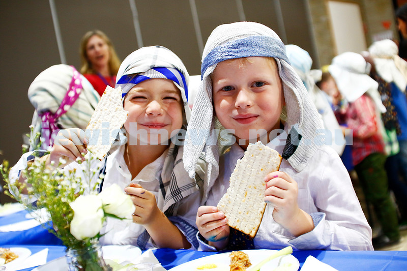 3-4-17. Passover and model seder at Mount Scopus, Gandel Besen House. Prep students Coby Segal (left) and Jesse Zelman enjoy their matzah. photo: Peter Haskin