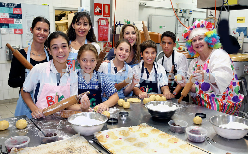A group of Students from Bellevue Hill Public school bake Hamantashen at OBK. Pic Noel Kessel
