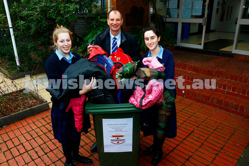 "27-6-17. David Southwick at Beth Rivkah Ladies College with Esti Cohen (left) and Yakiira Ossip gathering up coats for the ""hugoswarmth"" drive. Photo: Peter Haskin"