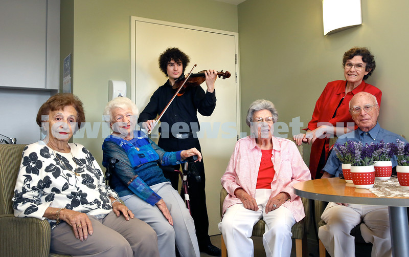 Gerald Westheimer (right) with young violinist Ben Adler with a vintage violin. Pictured at Montefiore Home in Randwick. Pic Noel Kessel.
