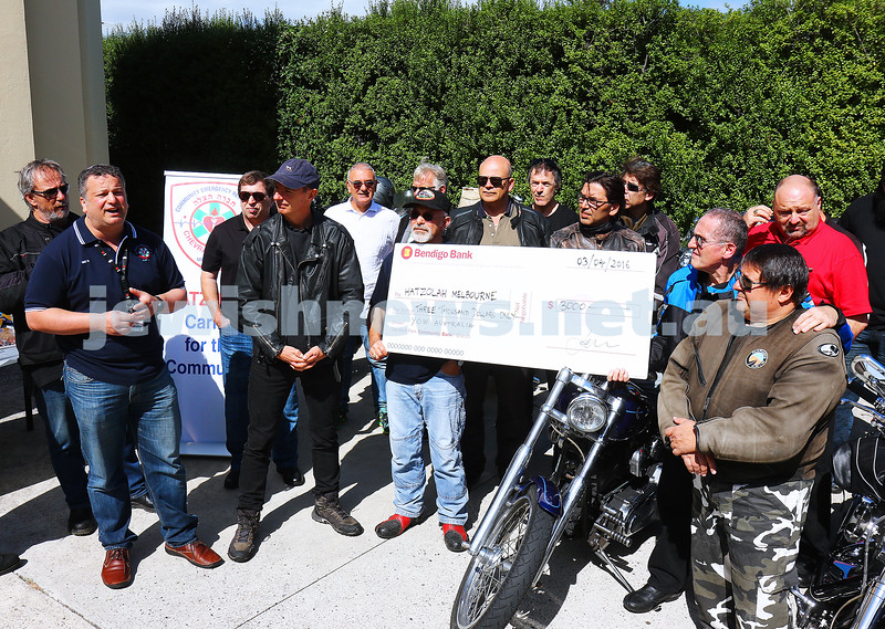 3-4-16. Hatzolah's Danny Elbaum accepts a cheque from Members of YOW (Yids on Wheels)  for $3000. Photo: Peter Haskin
