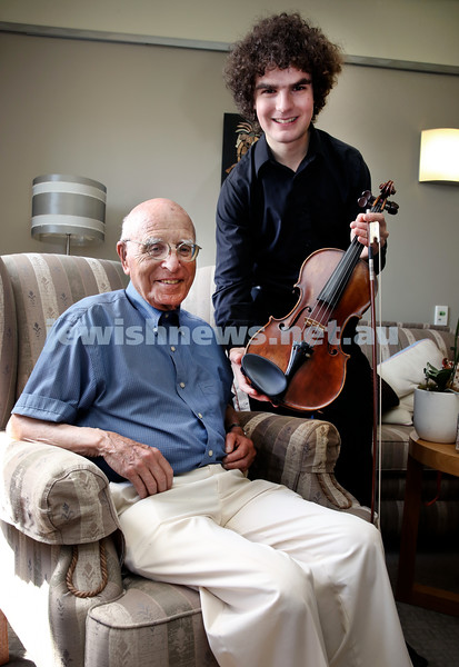 Gerald Westheimer with young violinist Ben Adler with a vintage violin. Pictured at Montefiore Home in Randwick. Pic Noel Kessel.
