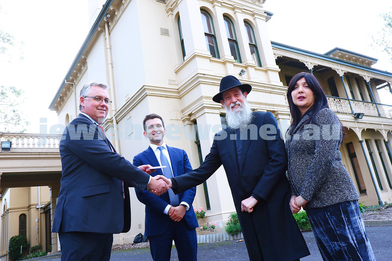 10-5-16. 12 Chapel St. Property hand over for the new school known as Cheder Levi Titzchok. From left: David Sinden ( Salvation Army), Josh Rutman (CBRE), Eliezer and Nicole Kornhauser. Photo: Peter Haskin