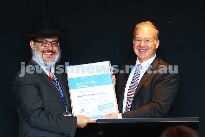 11-4-16. Accreditation presentation. Safeguarding children program. Rabbi Yehoshua Smukler receives accreditation certificate from Andrew Blode, CEO of Jack and Robert Smorgon Families Foundaton. Photo: Peter Haskin