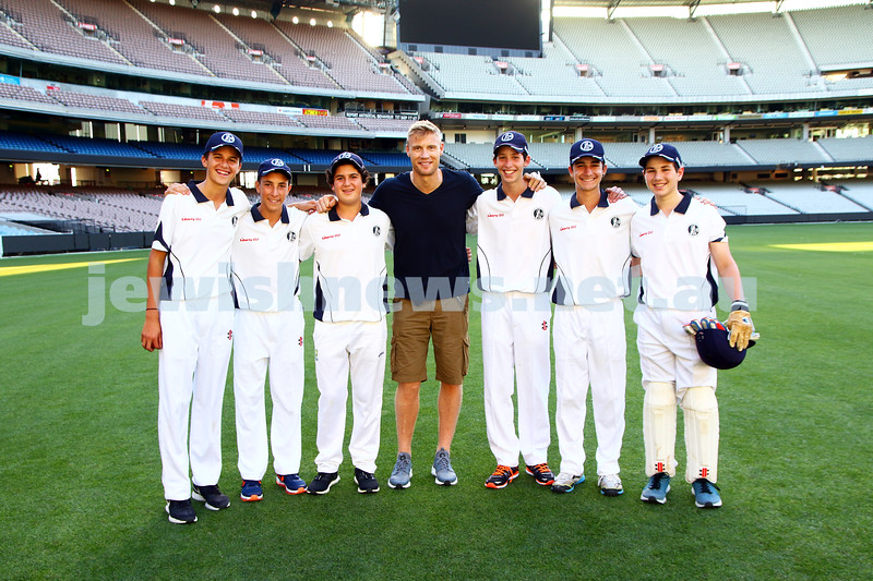8-2-16. English cricketer Freddy Flintoff with members of the Maccabi Junior cricket club on the MCG. Photo: Peter Haskin