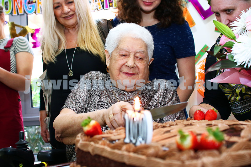 16-5-16. Anne Bernstein cuts her 100th bithday cake at Jewish Care's Gary Smorgon House. Photo: Peter Haskin