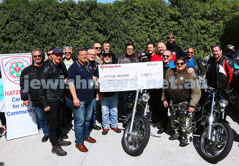 3-4-16. Members of YOW (Yids on Wheels) present Hatzolah's Danny Elbaum with a cheque for $3000. Photo: Peter Haskin
