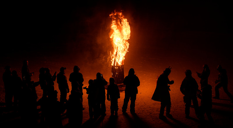 Guests bring in the winter season by sacrificing skis and snow boards to ULLR, the Norse god of snow at Brian Head Resort Saturday, December 8, 2018. The celebration included live music, a drum circle, and fire dancing.