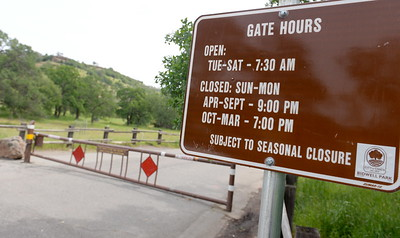 The gate at Horseshoe Lake in Upper Bidwell Park shows a sign of when it is open to the public however the gate was closed in Chico, Calif. Wed. April 19, 2017 at 11:00 a.m.. (Bill Husa -- Enterprise-Record)