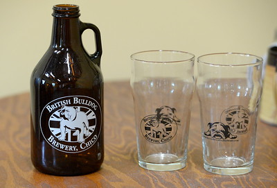 A growler and beer glasses sit on a counter at the British Bulldog Brewery seen during a tour of the facility in Chico, Calif Mon. April 17, 2017. The golden retriever is Hugo.  (Bill Husa -- Enterprise-Record)