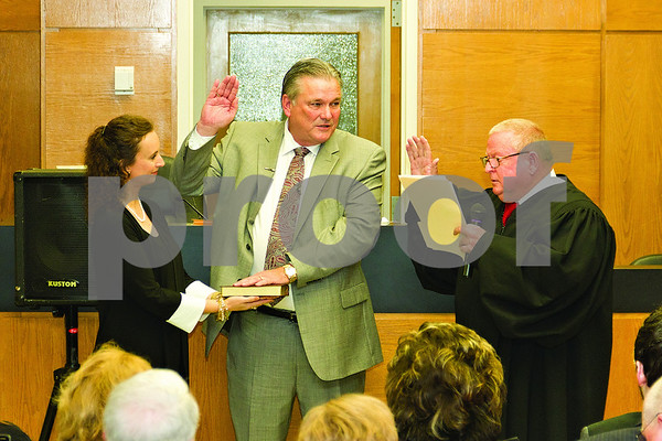 Photo by Shannon Wilson / Tyler Morning Telegraph Judge Jack Skeen Jr. swears in Sheriff Larry R. Smith at the Oath of Office Ceremony at the Smith County Courthouse on Tuesday morning.
