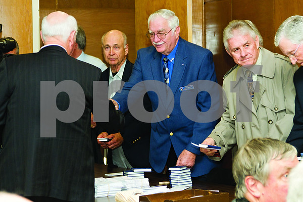 Photo by Shannon Wilson / Tyler Morning Telegraph Gideons present Bibles to Smith County Sheriff's Office Deputies and employees along with pocket Constitutions provided by U.S. Congressman Louie Cohmert at the Oath of Office Ceremony at the Smith County Courthouse on Tuesday morning.